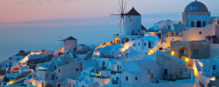 After sunset hour at Oia village of Santorini island in the  Cyclades, aegean sea, Greece.