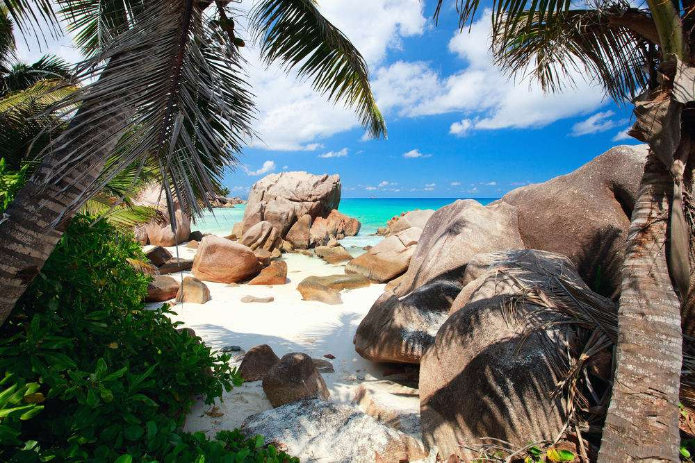 Beautiful little secluded beach at La Digue island in Seychelles